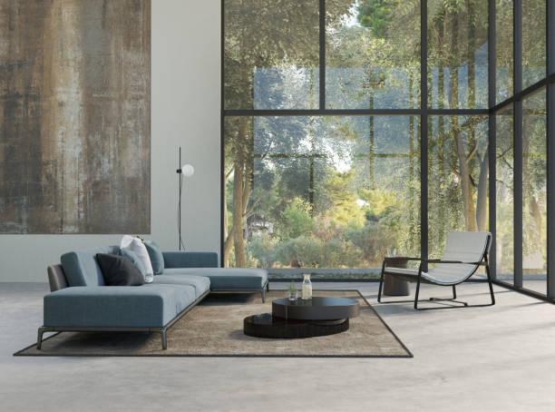 loueur meublé professionnel. Salon intérieur avec un canapé et de grandes baies vitrées