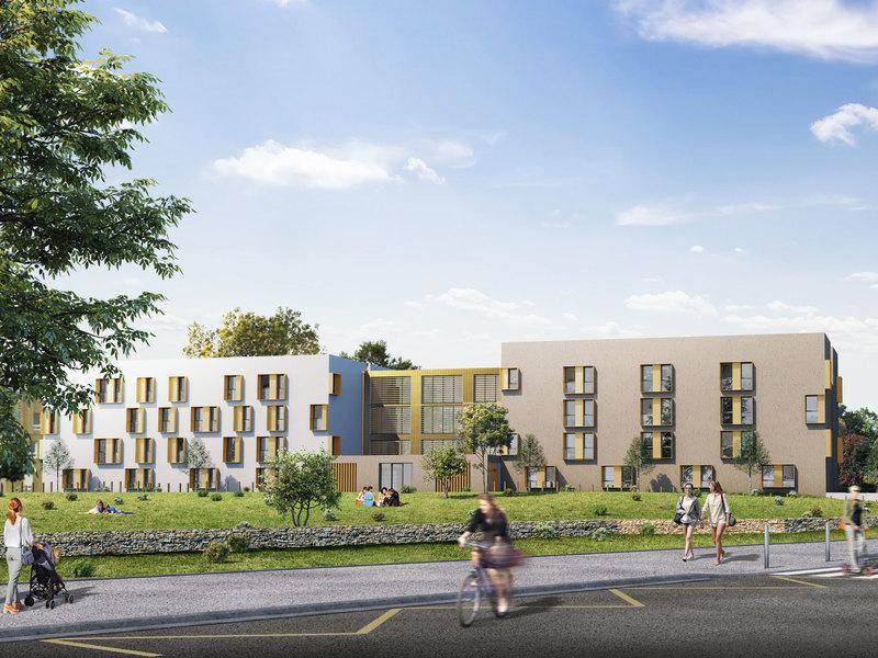 acheter louer-façades résidence neuve espaces verts rue passants ciel nuageux