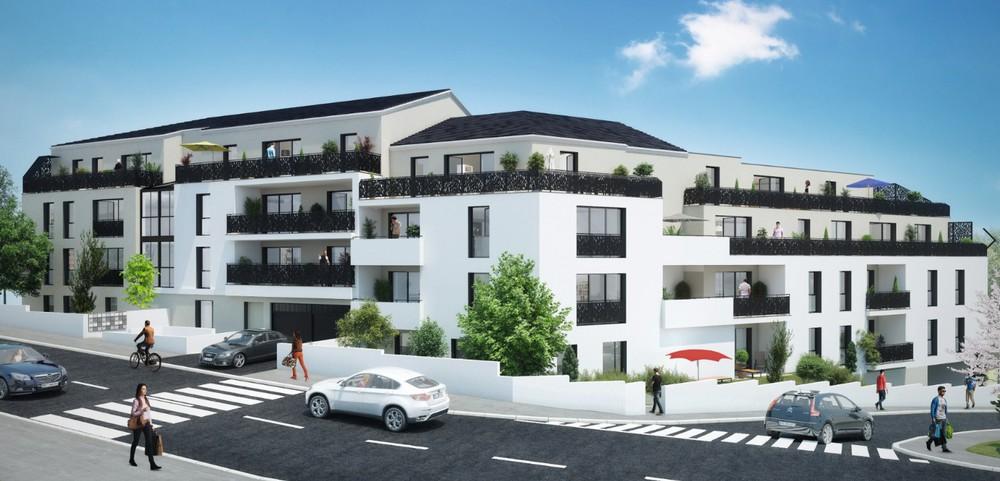 investissement immobilier-résidence neuve rue passants voitures ciel bleu