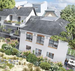 investisseur locatif-résidence espaces verts ciel nuageux